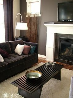 Modern TV and Fireplace with Dark Elegant Sofa and Furniture in Living Room Interior Decorating Designs Ideas