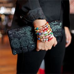 Sophisticated clutch purse made from recycled VHS tapes.