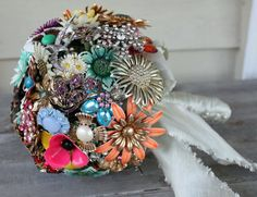 Turn vintage brooches into a wedding bouquet. For someone else. :}