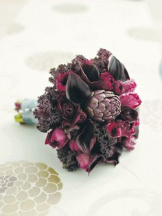 Purple artichoke, black callas, and kale make an innovative bouquet // Seattle Bride