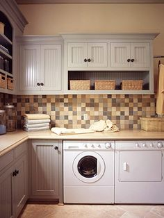 Love the warmth of this laundry room