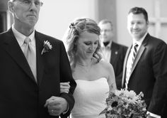 A beautiful bride moment walking down the isle with her father. Photo by Whitmeyer Photography