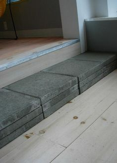 use simple Concrete Patio Pavers  which cost less than a dollar each, to create an instant step.
