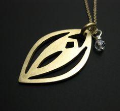 The Love Necklace-brass vagina  via ArtByWinona on Etsy.