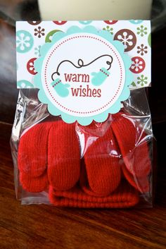 Such a cute gift idea - Cheap gloves packed in cellophane with a pretty little bag topper