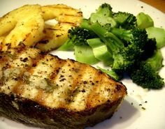 grilled halibut steaks dressed with lemon-dill-garlic butter with grilled pineapple and sea salt dusted steamed broccoli by aarn!, via Flick...