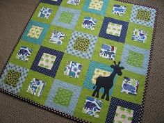Love the jungle prints and the addition of the applique giraffe just makes this quilt perfect for baby!