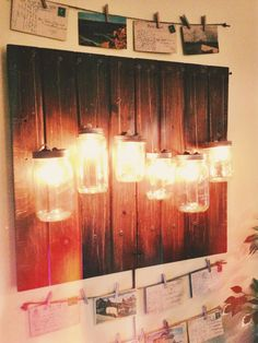 Custom Mason Jar Light Fixture / [DK] Couldn't find a mason jar design on Pinterest that i liked so I just made up my own! // made from hemp, assorted jars, a low-wat strand of bulbs, two old cabinet doors, screws & a drill. //