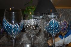 Hand Painted Wine Glasses - Peacock Themed Bridal Shower Favors. $10.00, via Etsy.