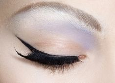 Subtle blue shadow with winged eyeliner