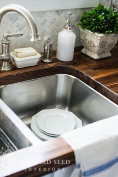 butcher block countertop, under-mount sink, pretty faucet, and LOVE the marble backsplash