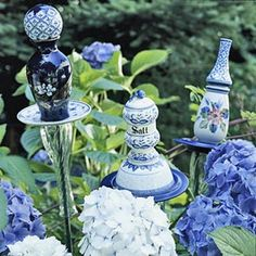"""DIY Garden Totems ~ Glass Sculptures .... The blues, whites and pattern in this are so perfect with the hydrangea! All you need are sturdy garden stakes, or piping, outdoor clear silicone glue, and any glassware you fancy! I would love to make a mini """"Alice in Wonderland Tea Party"""" ~ Or """"The Secret Garden"""" themed version to install in a small garden for our daughter and granddaughter white gardens, old dishes, glasses, blue, garden art, yard art, garden stakes, garden totems, glass garden"""