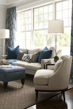 Kate Singer Sitting Room at the Hampton Designer Showhouse - pretty pillows on couch and ottomon- I love this room...I'd like to use it as one of my INSPIRATION ROOMS - like the blue's oatmeal colored furniture together - GREAT FOUNDATION