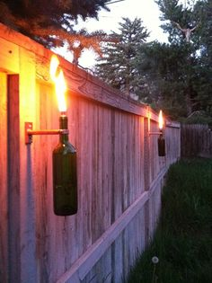 love this as a lighting option around the amazing patio space we will one day have. Tiki but a wino version!