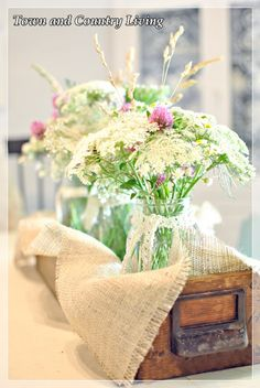 field flowers in Ball jars, linen and lace, rustic drawer || Town and Country Living - LOVE!