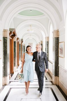 They eloped at City Hall - so romantic. I'm also in love with her blue wedding dress and bouquet.