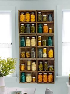 Learn how to mount old blueberry crates to a wall to display and store Mason jars. #craftidea