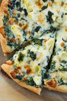 Spinach Artichoke Pizza - this is definitely one of the best pizzas I've ever made at home! It's a restaurant copycat recipe - made with bechemel sauce, provolone, mozzarella, parmesan, fresh spinach and canned artichoke hearts.