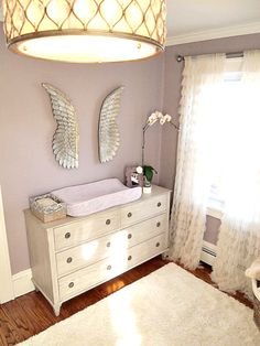 Angel wings over the changing table make this serene room so heavenly! #nurserydecor