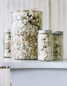 I use old glass jars to display my vintage game pieces and dice.  I like jars with metal lids and vintage aqua ball jars the best for shell collections at the beach house..