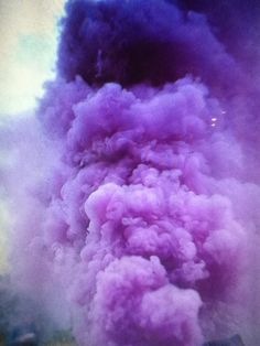 Billowing clouds of violet to purple.