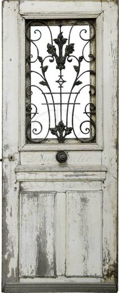 Beautiful old door for a garden gate! Or you could use a newer door, antique it and add an wrought iron or metal detail where the window is/was.