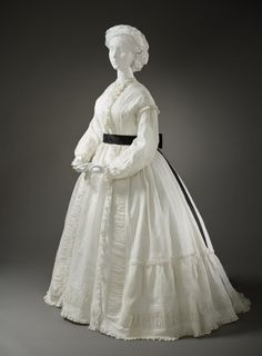 Woman's Morning Dress  Europe, circa 1865  Costumes; principal attire (entire body)  Cotton muslin  Center back length: 62 in. (157.48 cm)  Purchased with funds provided by Suzanne A. Saperstein and Michael and Ellen Michelson, with additional funding from the Costume Council, the Edgerton Foundation, Gail and Gerald Oppenheimer, Maureen H. Shapiro, Grace Tsao, and Lenore and Richard Wayne (M.2007.211.667)  Los Angeles County Museum of Art
