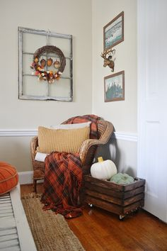 Love the rustic throw and the pumpkins in a crate