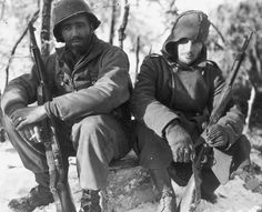 Two GIs, Lloyd Spencer & James Bryson, of the US 26th Infantry division, take a break shortly after New Year's in 1945.