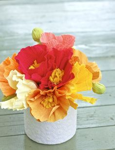 Crepe paper poppies in DIY lace decoupaged container.  Looks easy enough.