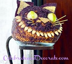 Cheshire-Cat-Cheesball!  I wish I could find a stand to display this like they have!  What a great food idea for an Alice in Wonderland Party! #wonderland #partyfood