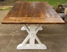 This is the table I want for the nook/bench area in the kitchen. Only smaller. Reclaimed Wood Trestle X Farmhouse Table by WonderlandWoodworks
