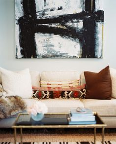 Wall Art Photo - A black-and-white painting hung above a white couch
