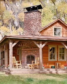 bright cabin house with outside fireplace