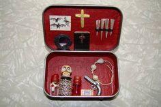 DIY Teeny Tiny Vampire Hunter's Kit. Made from Altoids' Tin. #diy #crafts #halloween #vampires #bats #skulls #crosses #stakes