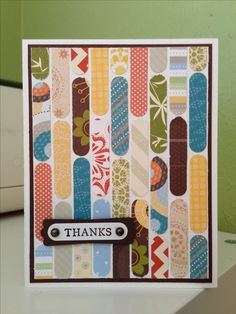 """This handmade Thank You card uses all your paper scraps cut with a word-window punch all lined up.  Stamp """"thank you"""" and cut with the same punch and attach using brads."""
