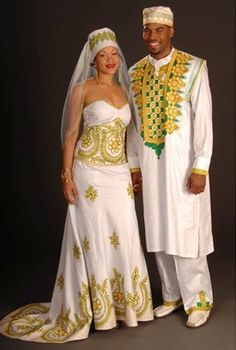 African couple's white brocade matching wedding outfits with embroidery. $450 #ItsAllAboutAfricanFashion #AfricanPrints #kente #ankara #AfricanStyle #AfricanInspired #StyleAfrica #AfricanBeauty #AfricanFashion