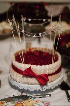 Cake with miniature bunting...  Photography by http://lillianandleonard.blogspot.com.  Full wedding here http://bit.ly/GVJrNt