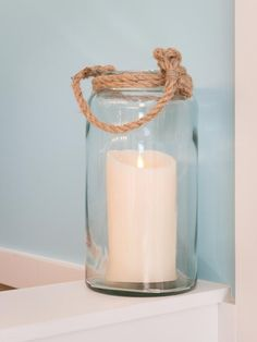 Mason Jars Wrapped With Nautical Roping >> http://www.diynetwork.com/blog-cabin/blog-cabin-2013-master-bathroom-pictures/pictures/index.html?soc=bc