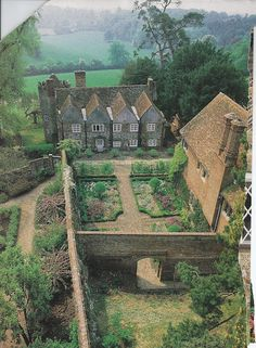 Victoria magazine often took us to England.  Here we get a bird's eye view of a spectacular manor house walled garden.
