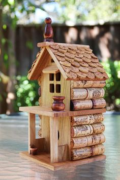 """Birdhouse """"Two Story with Porch"""", wood and wine corks. Sally from Paso Robles has these for sale on Etsy."""