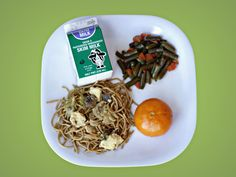 Singaporean Food Day: Singaporean Bee Hoon with egg strips over whole grain vermicelli, stir fried carrot & green beans, fresh tangerine & milk