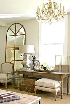 """this mirror would be great in our living room - maybe on the wall shared with the laundry room -  to """"mirror"""" the front window shape."""