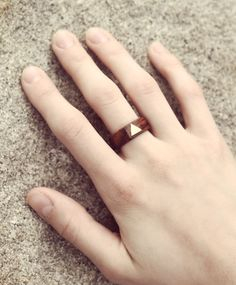 wood and brass triangle ring.