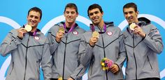(From left) Ryan Lochte, Conor Dwyer, Ricky Berens and Michael Phelps are golden.