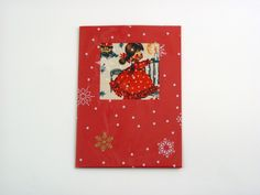 Christmas Night - A beautiful and versatile folded card made from the highest quality coloured card. Its pure solid colour flows through it's surface which features a crisp, original smooth finish. Card is decorated with designer vintage printed fabric and the finishing touch: printed cellophane. It comes with poppy red envelope in recyclable clear lidded box. Pack of 5.