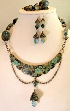 Beautifully etched necklace blanked altered with Swellegant to achieve the colors.  Apatite natural stone beads, and Swarovski dangles.  Designed and created by Marcia Tuzzolino of Aurora Designs at Fb.