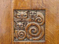 Three cats detail in a Art Nouveau wooden door
