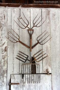 Pitchforks on a barn wall, love the idea of the Potting Shed!