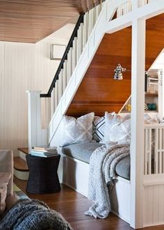 Get rid of that weird closet beneath the stairs...turn it into a comfy daybed. I love love love this! for the basement?